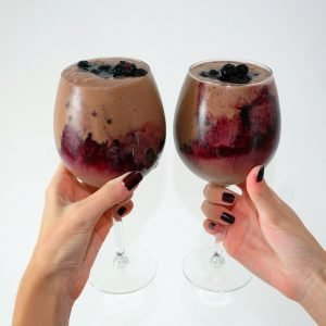 Delicious Raw Vegan Breakfast Milkshake made of raw cacao, nut butter and berries