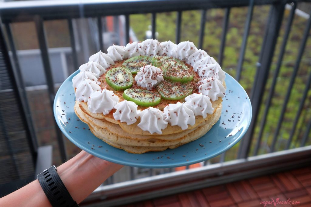 Vegan oil-free pancakes with kiwi, grated chocolate and our homemade vegan whipped cream